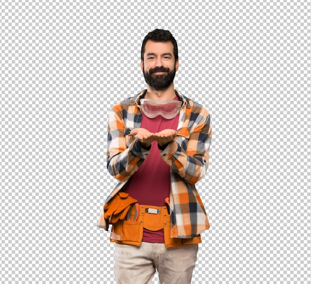 Craftsmen man holding copyspace imaginary on the palm to insert an ad
