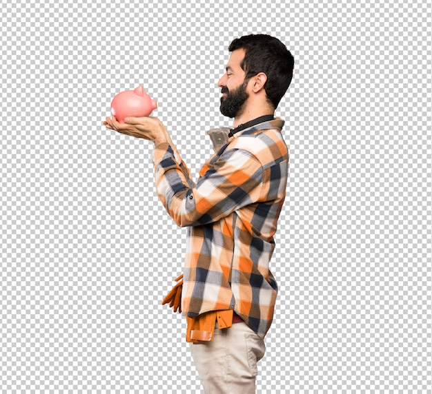 Craftsmen man holding a piggybank