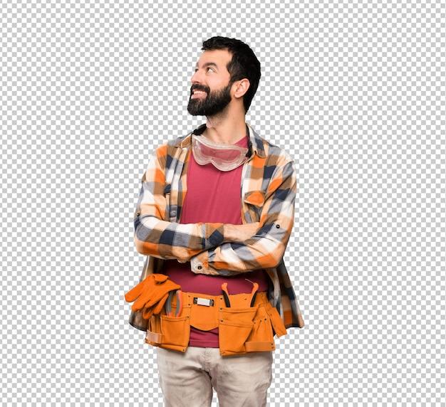 Craftsmen man looking up while smiling