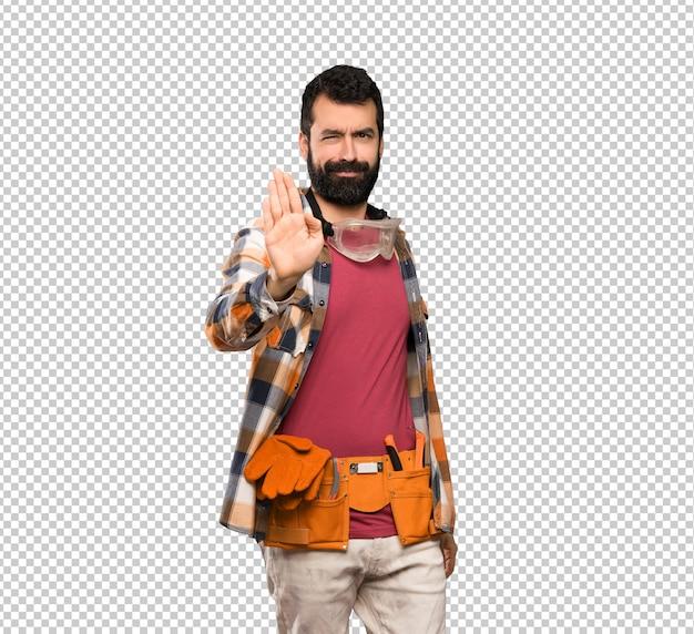 Craftsmen man making stop gesture