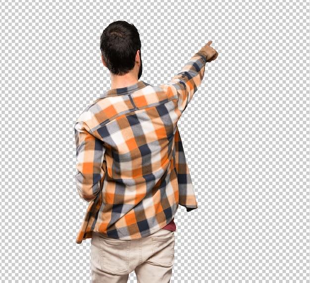 Craftsmen man pointing backwards