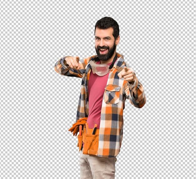 Craftsmen man points finger at you while smiling
