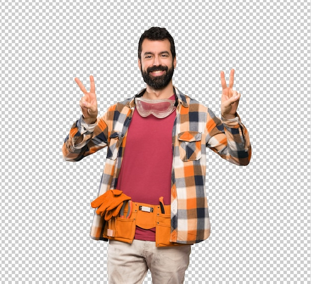 Craftsmen man showing victory sign with both hands
