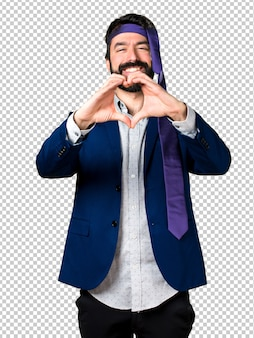 Crazy and drunk businessman making a heart with his hands