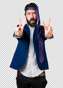Crazy and drunk businessman making victory gesture