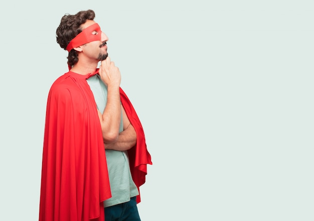 Crazy man as a super hero with a confused and thoughtful look, looking sideways, thinking
