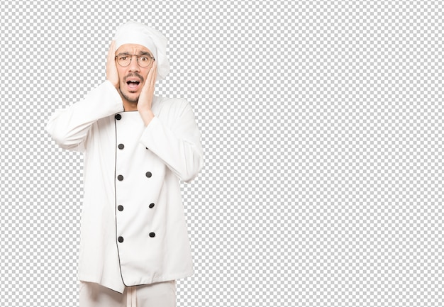 Crazy young chef making a gesture of despair