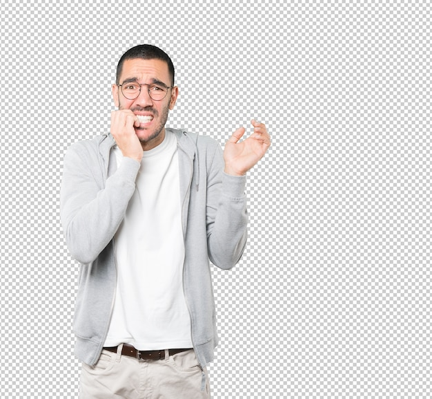 Crazy young man making a nervous gesture