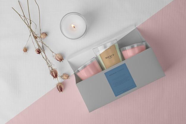 Assortimento creativo di confezioni di candele mock-up