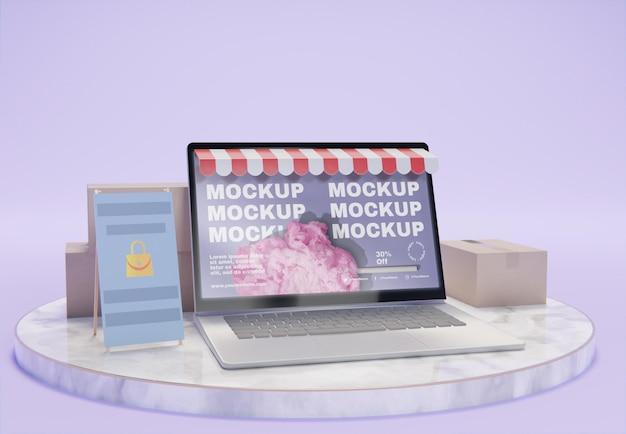 ノートパソコンのモックアップを使用したクリエイティブなビジネスアレンジメント