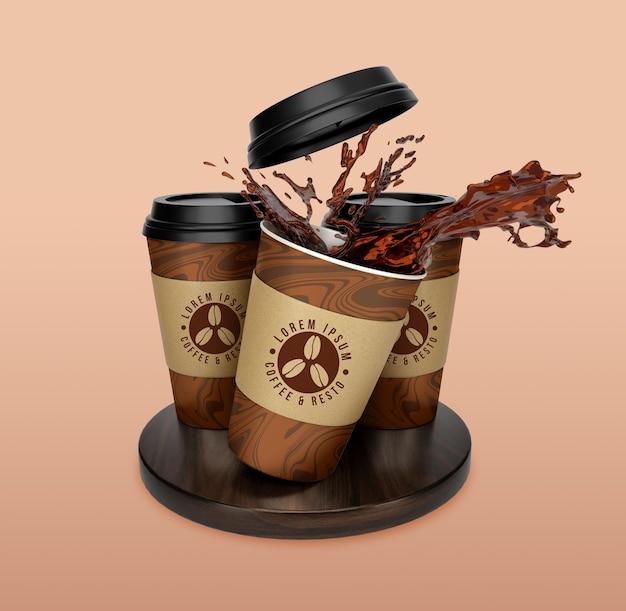 창조적 인 개념은 커피와 차 종이 컵 모형 디자인을 빼앗아갑니다.