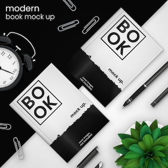 Creative, modern book cover mockup template of two books on black with alarm clock, paper clips, pen, and green plant, psd mock up