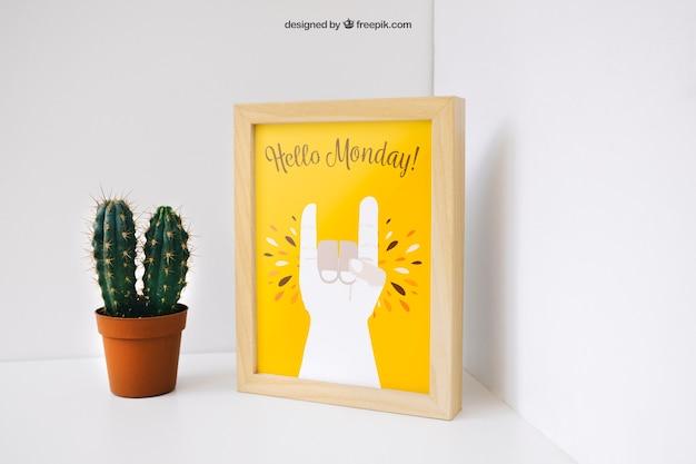 Creative photo frame mockup with cactus