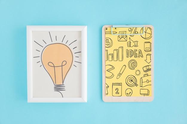 Concetto di creatività con telaio e appunti
