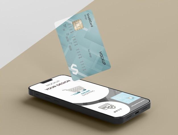 Макет кредитной карты с мобильным телефоном