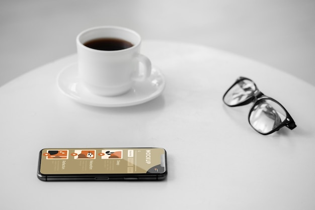 Cup of coffee and mobile