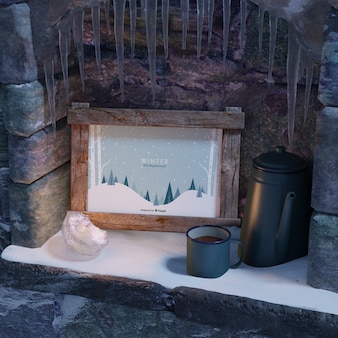Cup with tea beside winter frame