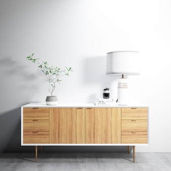 Cupboard with lamp and plant on it