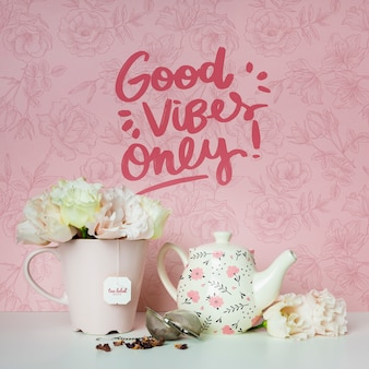 Cups and flowers with motivational quote