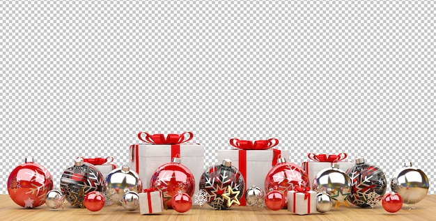 Cut out red christmas baubles and gifts lined up on wooden surface