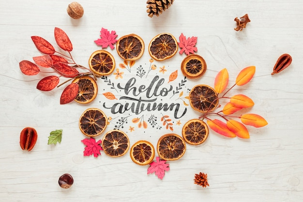 Cute autumn arrangement of leaves and dried oranges