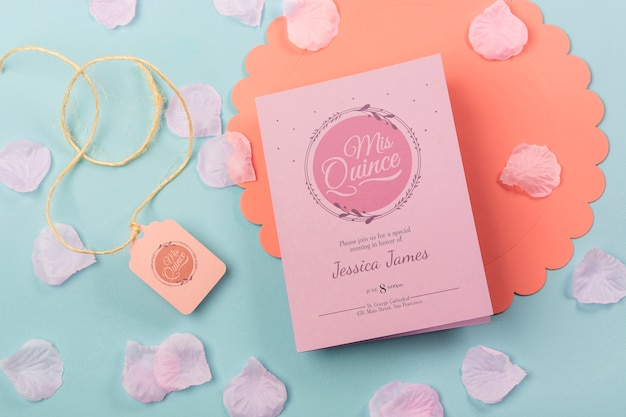 Cute fifteen birthday invitation with petals and rope