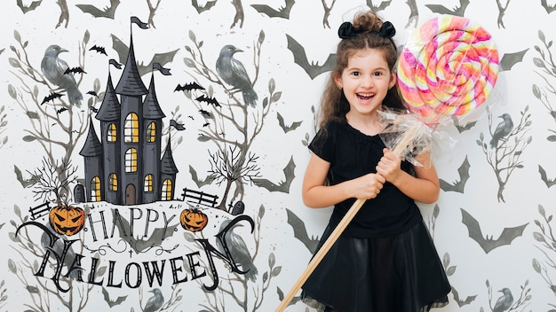Cute girl holding a giant lollipop halloween event