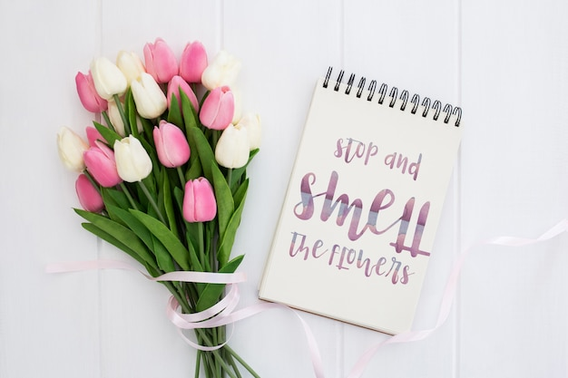 Cute message on notebook spring concept