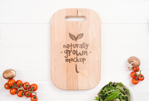 Cutting board and tomatoes vegan food mock-up
