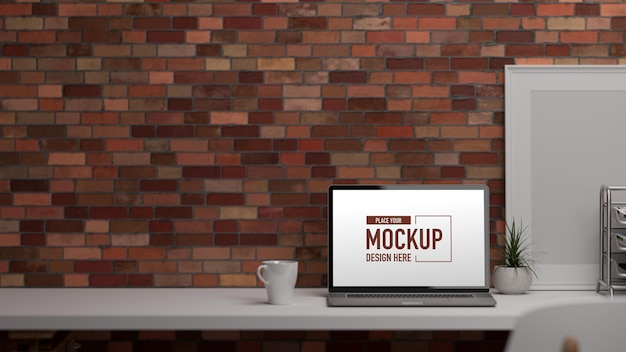 D rendering office desk with laptop supplies decorations and copy space on the table Premium Psd