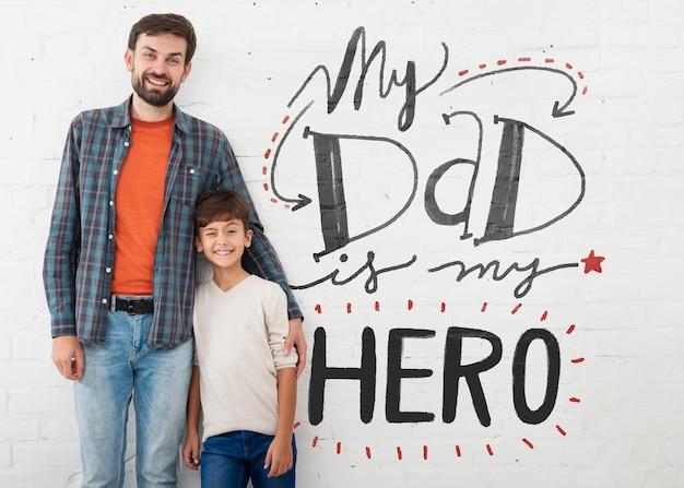 긍정적 인 메시지를 가진 아빠와 아들