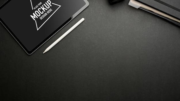 Dark creative flat lay workspace with digital tablet mockup on dark table