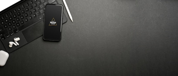 Dark creative flat lay workspace with smartphone mockup and accessories, top view