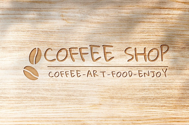 Psd макет логотипа deboss для кафе на деревянном фоне текстуры