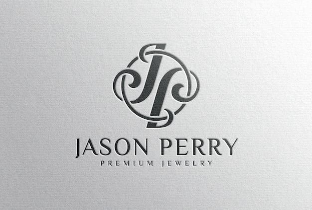 Мокап с тисненым черным логотипом на белой бумаге