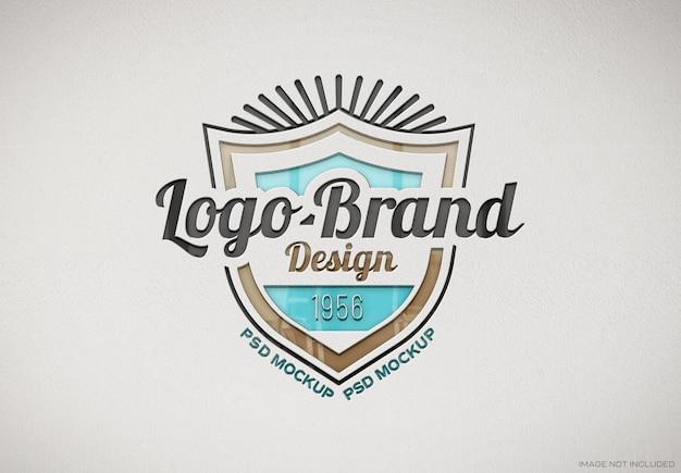 Debossed glossy logo on white paper texture mockup