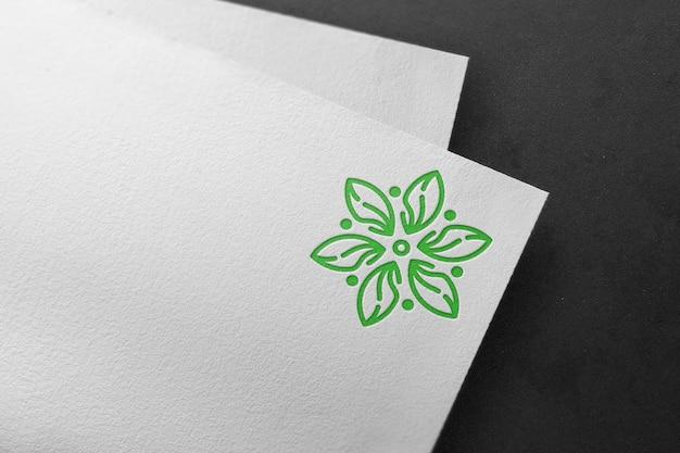 Debossed green logo mockup on white paper