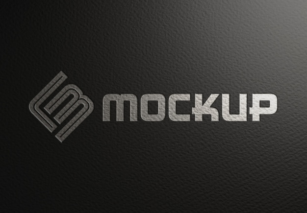 Debossed logo mockup on black paper texture