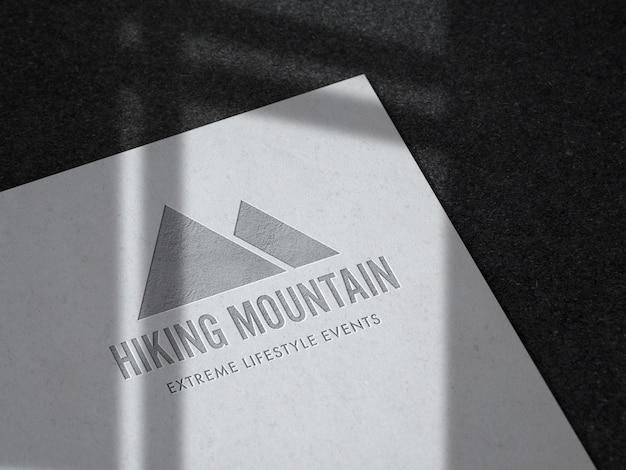 Debossed logo mockup on uncoated paper