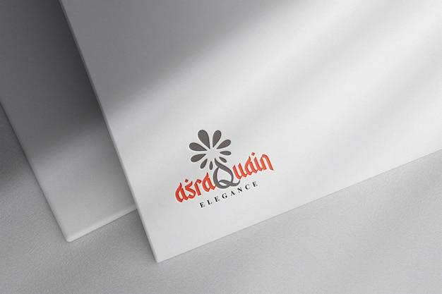 Debossed logo mockup on white paper