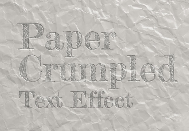 Debossed text effect on crumpled paper sheet texture mockup