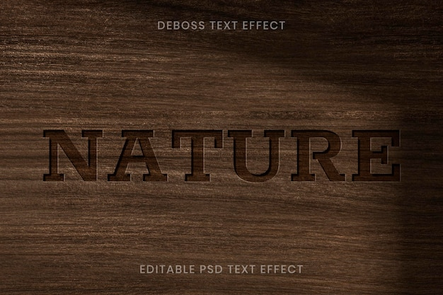 Debossed text effect psd editable template on wooden background