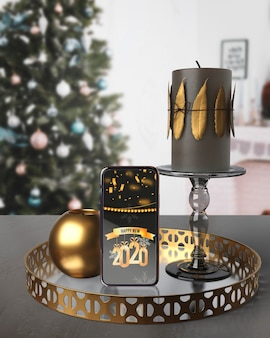 Decorations on tray beside phone with message for new year