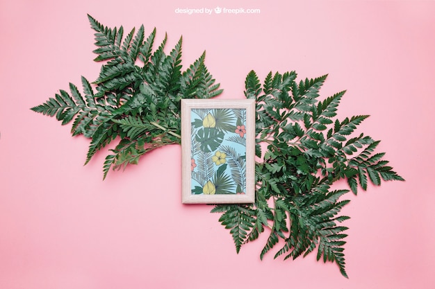 Decorative botanical mockup with frame and big leaves