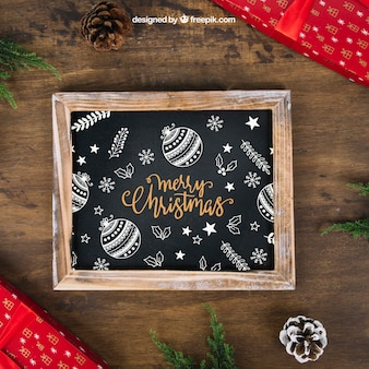 Decorative christmas mockup with slate and presents