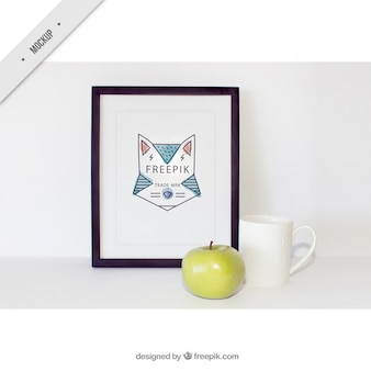 Decorative frame with an apple and a cup