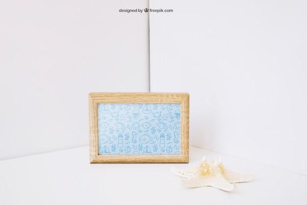 Decorative photo frame mockup with starfish