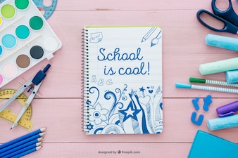 Decorative pink back to school composition with notebook