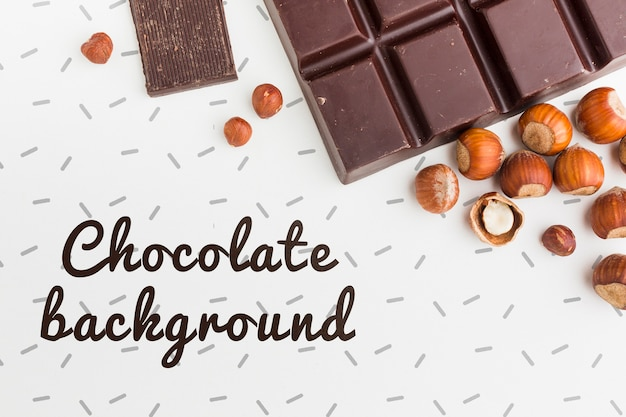 Delicious chocolate and chestnuts on white background mock-up