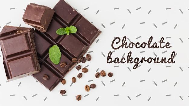 Вкусный шоколад на белом фоне макет